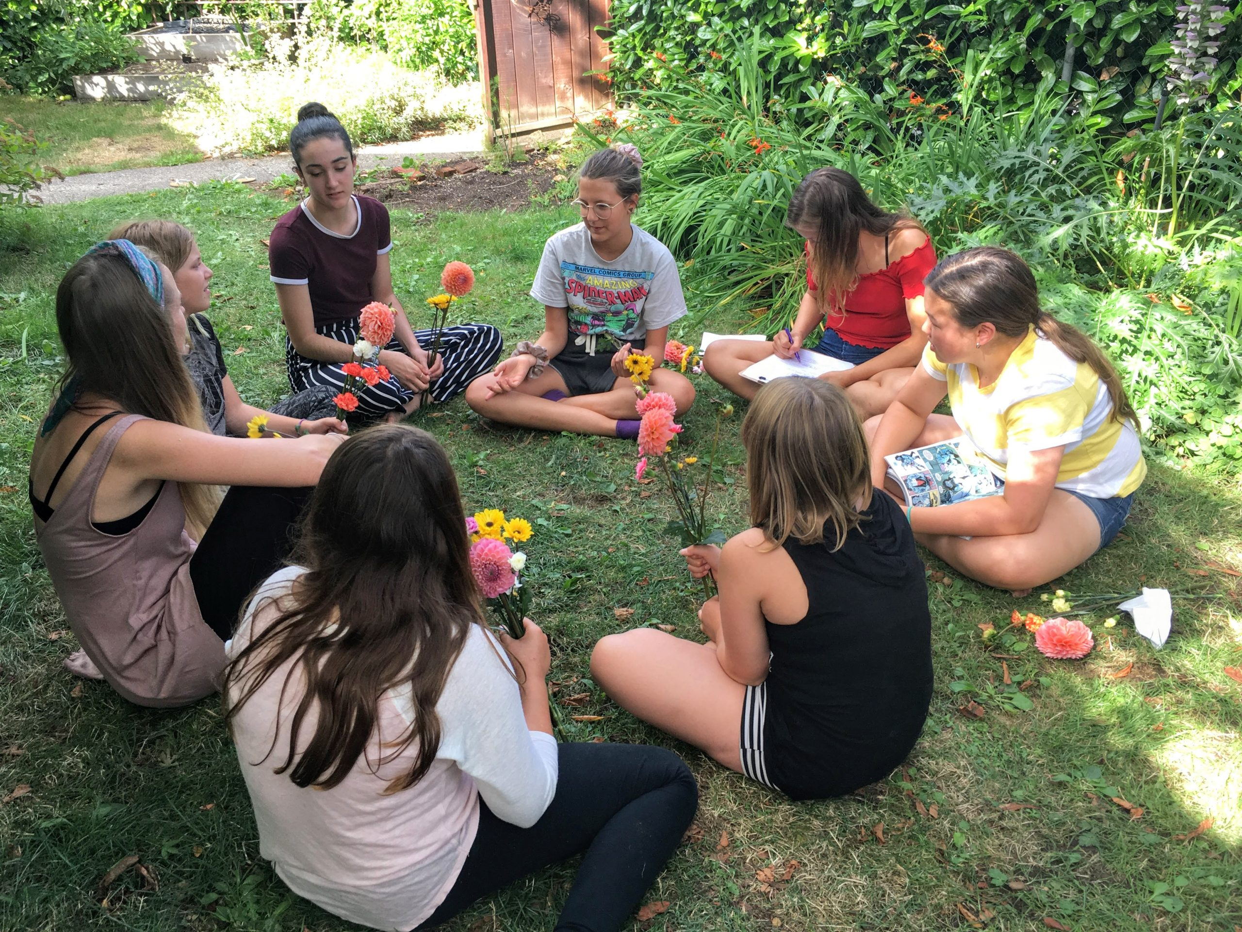 Girls sitting in a circle outdoors having a meaningful discussion