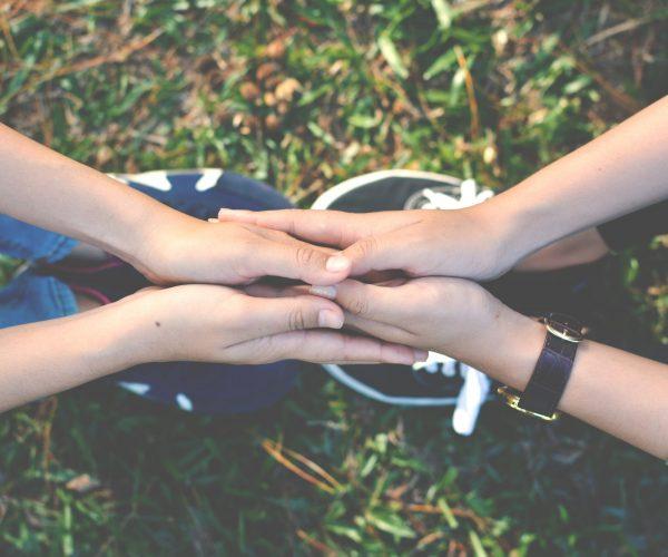 mentor holding hands